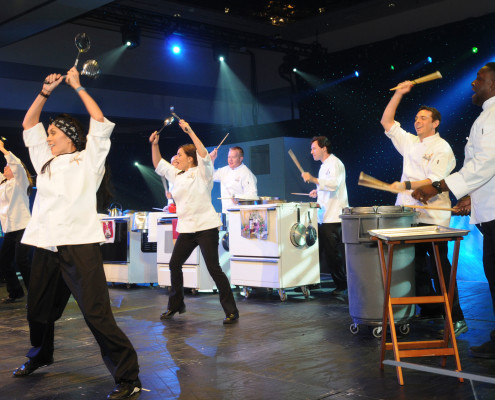 This customized show turned a corporation's kitchen equipment into instruments creating a unique opening number for this corporate awards program revealing the company CEO as part of the act!