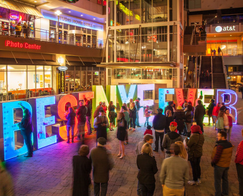 To create social media buzz on New Year's Eve for a product launch we created interactive vignettes all over Charlotte. These oversized 3D letters encouraged people to leave something in exchange for anything else they found on the wall.