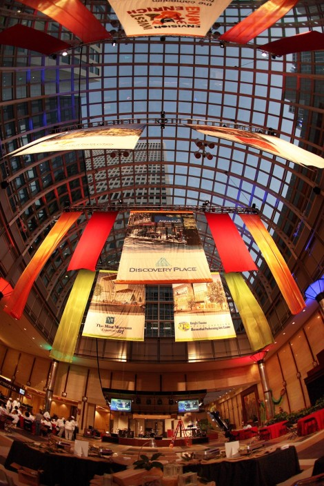 Custom banners hung from the ceiling create a more intimate environment and provide sponsor recognition at the same time.